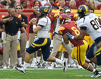 Kevin Riley of California keeps his distance away from USC defenders during the game at LA Memorial Coliseum in Los Angeles, California.  USC defeated California, 48-14.