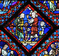 God speaking to Noah through Christ, telling him to build an ark to save his family and the animals from the flood, from the Life of Noah stained glass window, 13th century, in the nave of Chartres cathedral, Eure-et-Loir, France. Chartres cathedral was built 1194-1250 and is a fine example of Gothic architecture. Most of its windows date from 1205-40 although a few earlier 12th century examples are also intact. It was declared a UNESCO World Heritage Site in 1979. Picture by Manuel Cohen