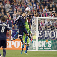 New England Revolution forward Milton Caraglio (9) battles for head ball. In a Major League Soccer (MLS) match, the Seattle Sounders FC defeated the New England Revolution, 2-1, at Gillette Stadium on October 1, 2011.
