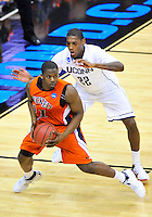 G.W. Boone of the Bison is defended by Roscoe Smith of the Huskies. Connecticut defeated Bucknell 81-52 during the NCAA tournament at the Verizon Center in Washington, D.C. on Thursday, March 17, 2011. Alan P. Santos/DC Sports Box