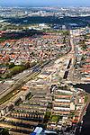 Nederland, Zuid-Holland, Delft, 09-05-2013; Spoorzone Delft, omgeving van het station (bouwput met gele kraan). .Omdat het bestaande spoorviaduct met slechts twee sporen een flessenhals vorm wordt dit vervangen door een spoortunnel. Verder komt er een ondergronds station, onder het nieuwe stadskantoor..Spoorzone Delft. Because the existing railway viaduct - through the historical inner city - has only two tracks it is a bottleneck. A new underground railway tunnel is being build, it will include an underground station, under the new city hall..luchtfoto (toeslag op standard tarieven).aerial photo (additional fee required).copyright foto/photo Siebe Swart