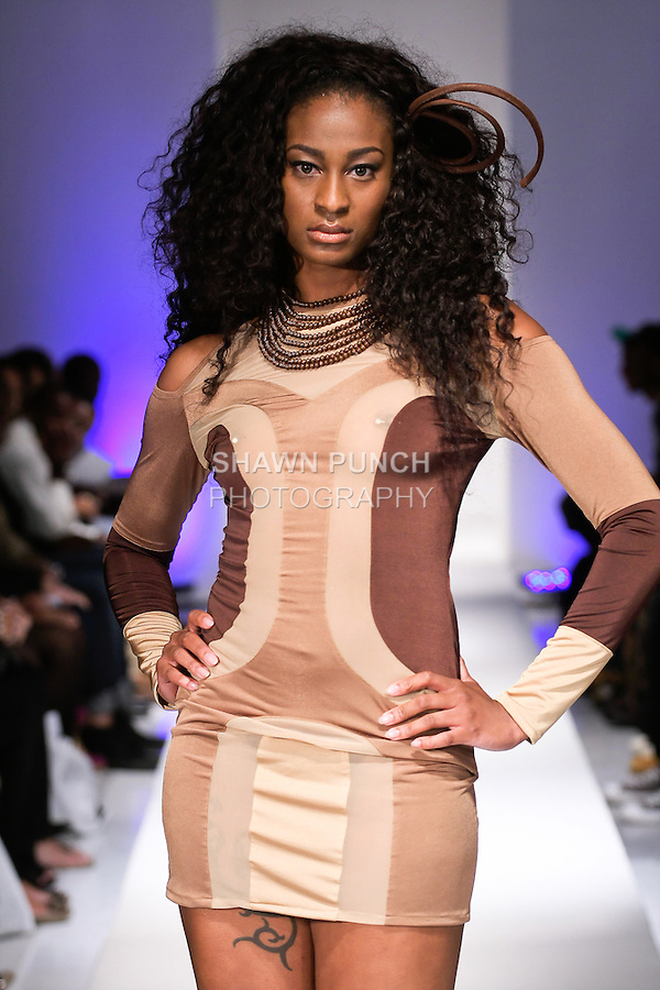 Model walks runway in a outfit from the John Guarnes Spring Summer 2013 collection, during BK Fashion Weekend Spring Summer 2013, September 29, 2012.