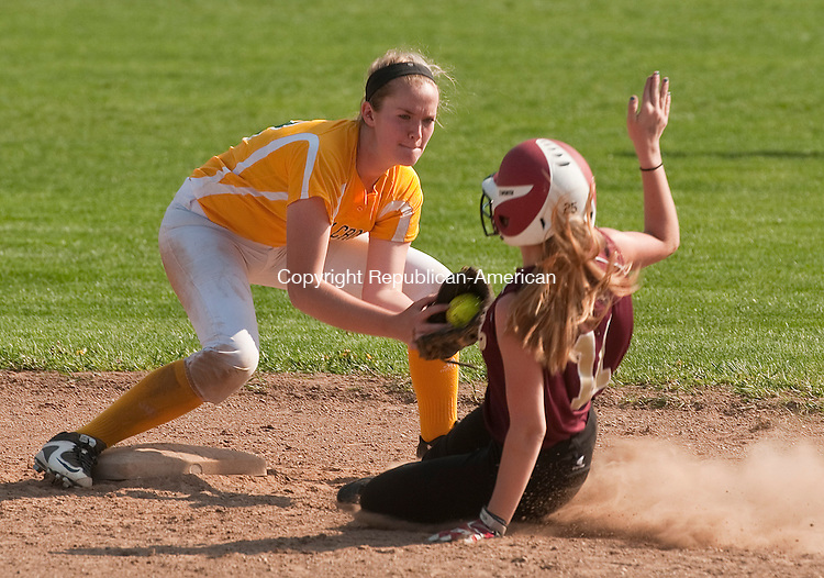 WATERBURY, CT--050815JS09-  Sacred Heart's Kayleigh O'Donnell (11) is called safe at second base, in front of the tag by Holy Cross' Paige Hine (12), during their game Friday at Holy Cross High School in Waterbury. <br /> Jim Shannon Republican-American