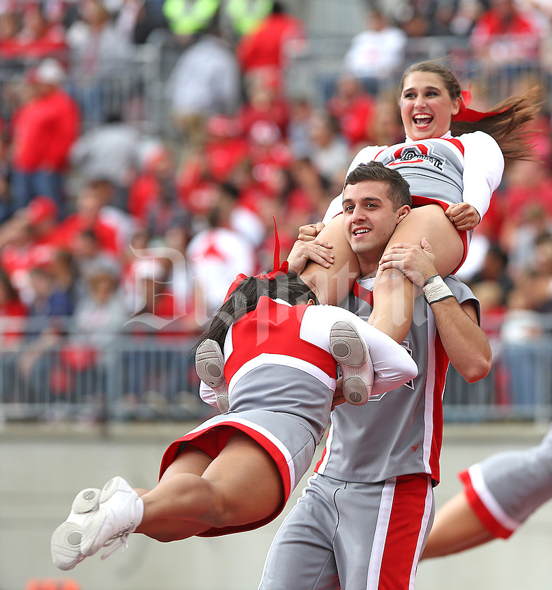 The OSU cheerleaders celebrate another touchdown against Kent State at Ohio Stadium on September 13, 2014.  (Chris Russell/Dispatch Photo)