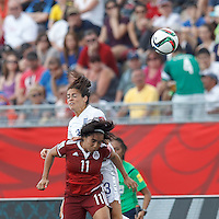 Moncton, New Brunswick - June 13, 2015: First half action. In a FIFA Women's World Cup Canada 2015 Group F match, England (white) vs Mexico (maroon), 0-0 (halftime), at Moncton Stadium.<br /> .