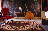 Antique musical instruments embellish the plush furnishings of this room
