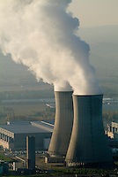 Smoke emitting from cooling towers at a nuclear power plant in the Rhone River Valley, Drome, France.