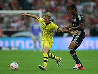 FUSSBALL   1. BUNDESLIGA   SAISON 2012/2013   SUPERCUP FC Bayern Muenchen - Borussia Dortmund            12.08.2012 Marco Reuss (li, Borussia Dortmund) gegen Luiz Gustavo (FC Bayern Muenchen)