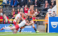 Picture by Allan McKenzie/SWpix.com - 13/05/2017 - Rugby League - Ladbrokes Challenge Cup - Castleford Tigers v St Helens - The Mend A Hose Jungle, Castleford, England - St Helens' James Roby clings on as Castleford's Greg Eden makes yardage.