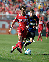 Chicago Fire defender Gonzalo Segares (13) passes the ball in front Manchester United midfielder Tom Cleverly (35).  Manchester United defeated the Chicago Fire 3-1 at Soldier Field in Chicago, IL on July 23, 2011.