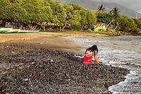 A girl looks for shells at Hanaka'o'o Beach Park on Maui.