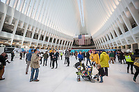 Visitors to the partially finished World Trade Center Transportation Hub, known as the Oculus, at its opening on Thursday, March 3, 2016. The over-budget, years late, $4 billion state-of-the-art transportation hub was designed by renowned architect Santiago Calatrava. When finished the hub will connect subway lines and PATH trains. (© Richard B. Levine)