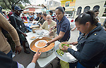 """Juani Martinez and other Methodists in Nuevo Laredo, Mexico, serve food to Cuban immigrants in that city's Plaza Benito Juarez on March 3, 2017. Hundreds of Cubans are stuck in the border city, caught in limbo by the elimination in January of the infamous """"wet foot, dry foot"""" policy of the United States. They are not allowed to enter the U.S. yet don't want to return to Cuba. Many of the city's churches have become temporary shelters for the immigrants, and congregations rotate responsibility for feeding the Cubans, who have slowly been forced to appreciate Mexican cuisine. Such solidarity from ordinary Mexicans is being tested these days, as not only are the Cubans stuck at the border, but the U.S. has stepped up deportations of Mexican nationals, while at the same time detaining many undocumented workers from other nations and simply dumping them on the US-Mexico border. Martinez is a member of the Aposento Alto Methodist Church in Nuevo Laredo."""