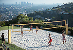 Editorial Travel Photography: People playing beach volley at 1 electra court contemporary villa in Hollywood Hills, Los Angeles, California, USA