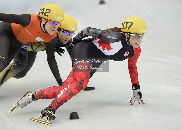 Valerie Maltais (CAN) leads from Jorien ter Mors (NED). Womens 1000m - Short track skating - Iceberg skating Palace - Olympic Park - PHOTO: Mandatory by-line: Garry Bowden/SIPPA/Pinnacle - Photo Agency UK Tel: +44(0)1363 881025 - Mobile:0797 1270 681 - VAT Reg No: 768 6958 48 - 210214 - 2014 SOCHI WINTER OLYMPICS - Olympic park, Sochii, Russia