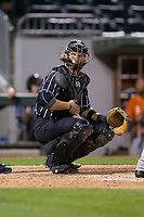 Charlotte Knights catcher Kevan Smith (32) looks to the dugout as he gives signs during the game against the Norfolk Tides at BB&T BallPark on May 2, 2017 in Charlotte, North Carolina.  The Knights defeated the Tides 8-3.  (Brian Westerholt/Four Seam Images)
