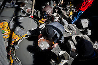 Miners separate gold from finely ground rock, using mercury and a pan, during the artisanal processing of gold ore in La Rinconada, Peru, 4 August 2012. During the last decade, the rising price of the gold has attracted thousands of people to La Rinconada in the Peruvian Andes. At 5300 metres above sea level, nearly 50.000 people work in the gold mines and live in the nearby colonies without running water, sewage system or heating service. Although the work in the mines is very dangerous (falling rocks, poisonous gases and a shifting glacier), the majority of miners have no contract and operate under the cachorreo system - working 30 days without payment and taking the gold they supposedly find the 31st day as the only salary. In spite of a demaged environment, caused by mercury contamination from the mining and the lack of garbage disposal, people continue to flock to the region hoping to find their fortune.