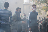 Egyptian protestors protect from tear gas shot by the security forces during violent clashes in central Cairo.