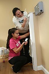 WATERBURY, CT31 December 2013-123113LW01 - Anele Barbieri, top, and her 14-year-old daughter, Gina Barbieri, apply a fresh coat of paint to the lobby at Art in Motion dance studio in Watertown Tuesday.<br />