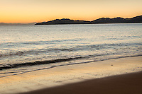 Sunrise on golden beach in Totaranui, Abel Tasman National Park, Nelson Region, New Zealand