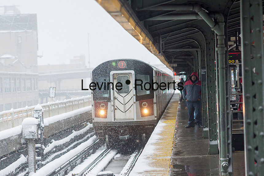 A Flushing Line train arrives at the Queensboro Plaza station in New York during the city's first major winter storm of the season on Thursday, February 9, 2017. Meteorologists are forecasting between 8 and 14 inches of snow in the New York City region. The Metropolitan Transportation Authority has had no major delays and the trains continue to run.  (© Richard B. Levine)