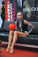 """Daria Kondakova of Russia watches for her scores from """"kiss & cry"""" during event finals at 2010 Grand Prix Marbella at San Pedro Alcantara, Spain on May 16, 2010. Daria won silver in AA at Marbella 2010. (Photo by Tom Theobald)."""
