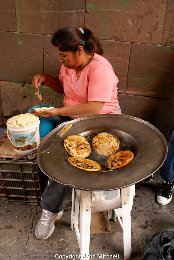 Mexican woman cooking tortillas on Canal Street in San Miguel de Allende, Mexico