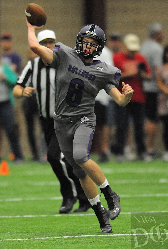NWA Democrat-Gazette/ANDY SHUPE<br /> Fayetteville plays Friday, May 29, 2015, during the Bulldogs' annual Spring Game inside the school's indoor facility in Fayetteville.