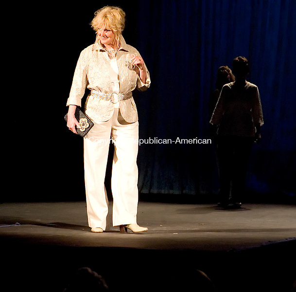 THOMASTON, CT- 04 MAY 2008- 050408JT04-<br /> Thomaston Animal Control Officer Cheryl Waldron models clothes from Coldwater Creek during Sunday's Women of Thomaston Fashion Show hosted by the Thomaston Woman's Club at the Thomaston Opera House. The event featured 24 models, including Thomaston native Katheryn Rice, who was recently featured in &quot;Harold and Kumar 2 Escape from Guantanamo.&quot;<br /> Josalee Thrift / Republican-American