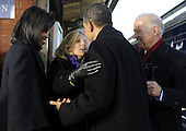 Wilmington, DE - January 17, 2009 -- United States President-elect Barack Obama (R) greets Vice President Joe Biden wife, Jill, as Joe Biden (R) and Obama's wife, Michelle, watch on as the Obamas pick up the Bidens in Wilmington, Delaware, on the Whistle Stop Train Tour, on Saturday, January 17, 2009. The ceremonial trip will carry President-elect Obama, Vice President-elect Biden and their families to Washington for their inaugurations with additional events in Philadelphia, Wilmington and Baltimore. Obama will be sworn in as the 44th President of the United States on January 20, 2009. .Credit: Kevin Dietsch - Pool via CNP