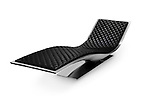 Sleek black leather with stainless steel lounge with futuristic ergonomic design isolated on white background with clipping path