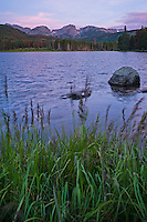 Sprague Lake at just before sunrise with Hallett Peak in the background. Rocky Mountain National Park, Colorado.