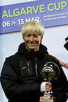 USA's Megan Rapinoe holds the trophy of best player after their Algarve Women's Cup soccer match final against Germany at Algarve stadium in Faro, March 13, 2013.  .