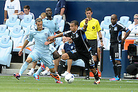 San Jose defender Jason Hernandez (21) moves past Graham Zusi... Sporting Kansas City defeated San Jose Earthquakes 2-1 at LIVESTRONG Sporting Park, Kansas City, Kansas.