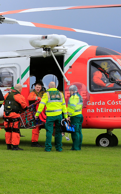 Rescue 116 crewman Ciaran Smith with crew man Derek Everitt at the landing site in Drogheda after completing a rescue transfer to Our Lady of Lourdes hospital<br /><br />Picture: www.newsfile.ie