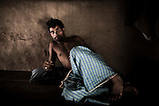 Dhaneshwar Dash poses for a portrait in his hut in village Dhinkhia, in Orissa, India. Proposed steel project would displace all families of this village so they are determined not to leave their soil. If the plant is constructed, the villagers from Dhinkia will be the first ones to be displaced.