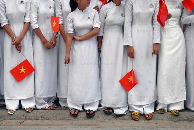 "Students dressed in the tradition ""ao dai"", line the streets of Hoi An, Vietnam, during a parade for visiting Chinese delegates...Kevin German / LUCEO"