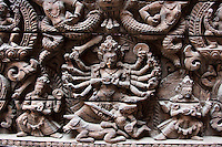 Kathmandu, Nepal.  Wood Carving showing the god Shiva above a Door in the Kumari Bahal, House of the Kumari Devi, a Young Girl Revered as a Living Goddess.  The wood used is sal wood, shorea robusta.  The house was constructed in 1757.