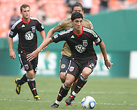 Pablo Hernandez #21 of D.C. United moves the ball away from Kyle Nakazawa #13 of the Philadelphia Union during an MLS match at RFK Stadium on August 22 2010, in Washington DC. United won 2-0.