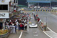 LE MANS, FRANCE - JUNE 11: The race-winning Sauber-Mercedes C9/88 88-C9-03 of Jochen Mass, Manuel Reuter and Stanley Dickens exits the pit lane during the 24 Hours of Le Mans at the Circuit de la Sarthe in Le Mans, France, on June 11, 1989.