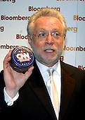 Washington, DC - May 1, 2004 -- CNN Anchor Wolf Blitzer holds up a box that he said contains a t-shirt as he arrives for the Bloomberg party following the 2004 White House Correspondents Association Dinner in Washington, D.C. on May 1, 2004..Credit: Ron Sachs / CNP.(RESTRICTION: No New York Metro or other Newspapers within a 75 mile radius of New York City)
