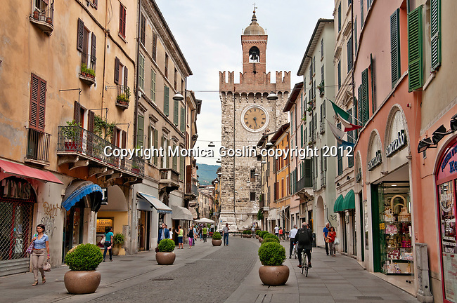 Street in Brescia, Italy with a Medieval tower in the background