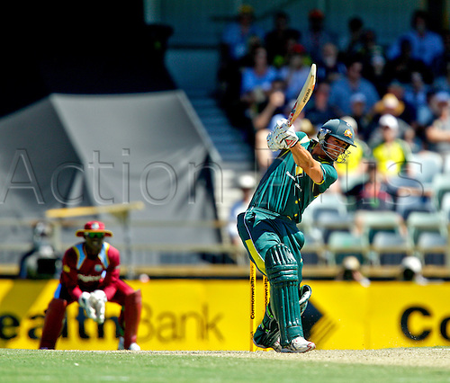 03.02.2013 Perth, Australia. Mitchell Johnson hits out  during the ODI between Australia and the West Indies from the WACA.