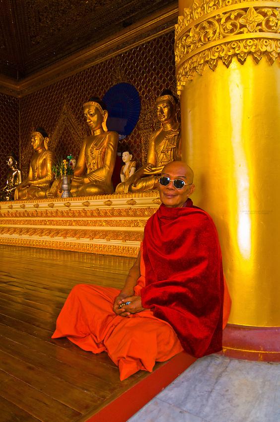 Buddhist monk wearing sunglasses, Shwedagon Pagoda, Yangon (Rangoon), Myanmar (Burma)