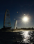 """Scott Babbage and Matt Day in a training session on his Moth Mach 2 in Sydney Harbour, Single-handed sailing dinghy with hydro-foils..Enter McConaghy Boats, builders of the """"Fastest Boats on the Planet"""". McConaghy Boats understand strong, light and fast and in no time at all McConaghy partnered with McDougall and began to build the next generation of foiling moths. Drawing upon the two names McDougall / McConaghy and acknowledging the name of the 2nd moth ever built by founder John McConaghy, they formed Mach 2 Boats Pty Ltd.."""