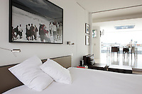 "The large photographic print hanging above the bed is entitled ""Presumed Reality"" by d'Ebbe Stub Wittrup"
