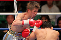 (L to R) Yota Sato (JPN), Suriyan Sor Rungvisai (THA), March 27, 2012, 2011 - Boxing : Yota Sato of Japan in action against  Suriyan Sor Rungvisai of Thailand during the WBC super fly weight title bout at korakuen hall in Tokyo, Japan. Yota Sato won the fight on points after twelve rounds. (Photo by Yusuke Nakanishi/AFLO) [1090]