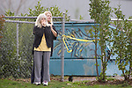 Two women watch the police activites near the scene of a shooting that killed four Lakewood Police Officers in Lakewood on Sunday, Nov. 29, 2009.  At about 8:00 this morning, a gunman walked into the Fornza Coffee shop while the four police officers were having coffee before their shift started and opened fire, killing all our law enforcement. Jim Bryant Photo. ©2010. ALL RIGHTS RESERVED.