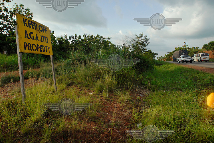 A cautionary sign, erected by the AngloGold Ashanti gold mining corporation, warns local people not to trespass..