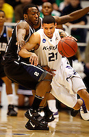 Kansas State guard Denis Clemente gets tightly guarded by Butler guard Grant Leiendecker as Kansas State takes on Butler at the NCAA Western Regionals  to decide who will advance to the final four of the NCAA basketball Championship. Photo taken at the EnergySolutions Arena in Salt Lake City, Utah Saturday, March 27, 2010.  August Miller, Deseret News .
